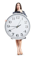 amazed woman holding big clock
