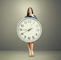 amazed woman with big white clock