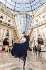 Beautiful and elegant dancer performing in Milan's shopping mall