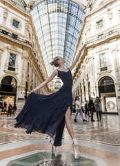 Beautiful dancer wearing blue dress and performing