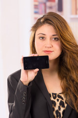 modern beautiful young woman holding cell phone