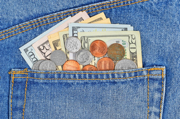 Money, coin and dollars in jeans pocket