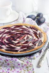 Homemade  tart with  cream cheese and plums