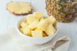 pineapple chunks in white bowl