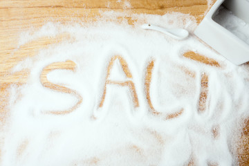 words SALT handwritten on salt