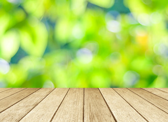 Perspective wood over blur trees with bokeh background
