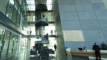 Time lapse of large business group in a light and modern office building