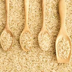 Jasmine rice in wooden spoon