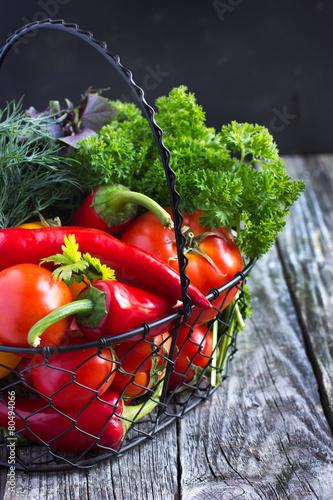 Poster fresh organic vegetables on the  basket