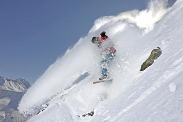 snowboarder sprays powder