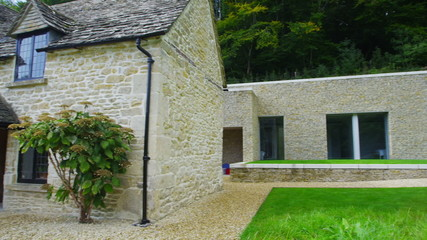 Exterior view of a traditional English cottage with contemporary built extension
