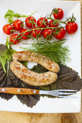 sausage a grill, tomatoes and greens