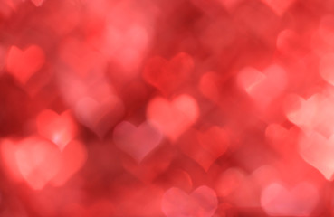 Abstract red background with heart-shaped boke
