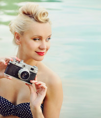 attractive young woman on the beach with vintage details, travel