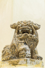 the ancient chinese lion statue under the sun light