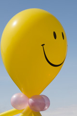 Yellow inflatable balloon with smile