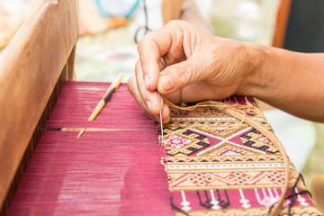 Woman hand weaving thai silk