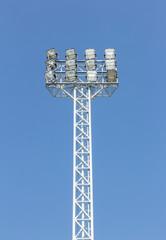 stadium spotlights with sky background