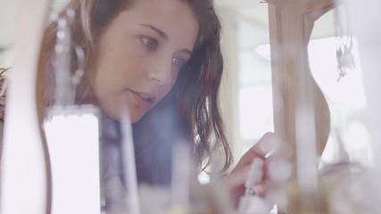 Attractive female shopper gazing into the jewelry cabinet