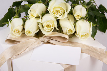 white roses, gift box and blank card for text