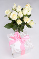 roses and gift box with blank card for text
