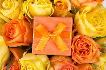 beautiful bouquet of roses and little gift box
