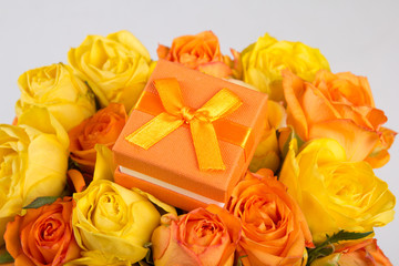 little gift box in beautiful bouquet of roses