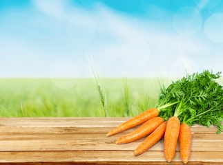 Carrot. Carrot vegetable with leaves isolated on white