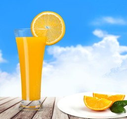 Fruit. Orange juice in glass with mint,  fresh fruits on wooden