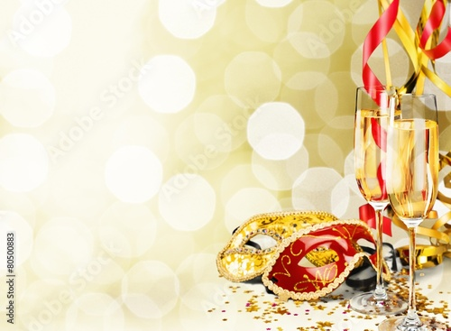 Alcohol. Flutes of champagne in holiday setting - 80500883