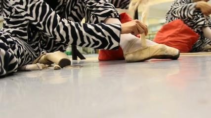 ballet dancer tie shoes, ready for ballet practice
