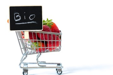 Bio strawberries in a shopping cart