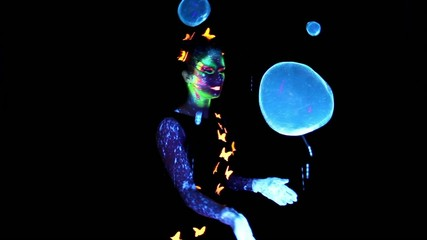 Young woman making group bubbles
