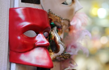 Red mask for sale in calle of Venice