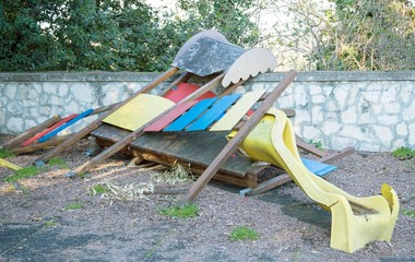 slide broken and abandoned in a deserted playground