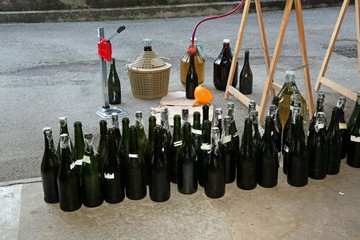 homemade bottling red wine in glass bottles