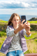 Smiling girl taking picture in Scotland Aberdeen and Grampian Hi