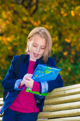 Outdoor portrait of a pretty girl school age