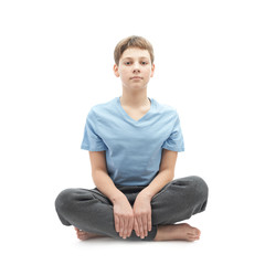 Young boy sitting in a lotus position