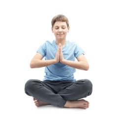 Young boy doing yoga