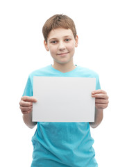 Happy smiling young boy with a sheet of paper