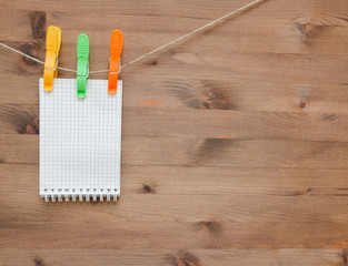 Hanging notebook  with colored clothespins