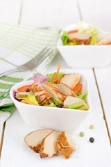 A fresh chicken salad in a heart shaped bowl