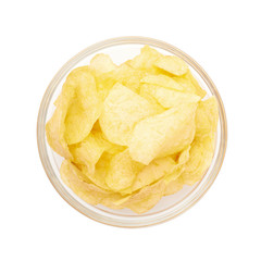 Multiple potato chips in a glass bowl
