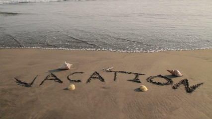 Vacation Sand Text Washed by Wave