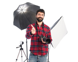 Photographer in his studio with thumb up