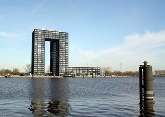 Modern appartment building and mooring posts in Groningen