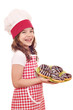 happy little girl cook with chocolate donuts