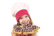 happy little girl cook with delicious chocolate donuts