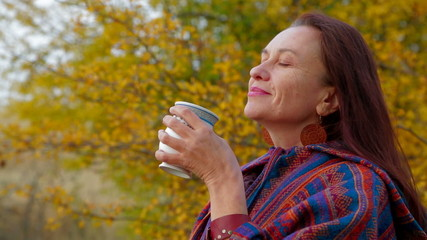 Woman Of Middle Age Drawing A Picture At Plein Air with mug of